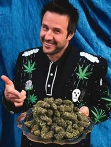 David Arquette holding marijuana. Celebrities smoking Marijuana.