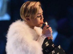 Miley Cyrus smoking marijuana on stage. Celebrities smoking weed.