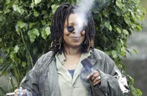 Whoopi Goldberg smoking a marijuana joint.